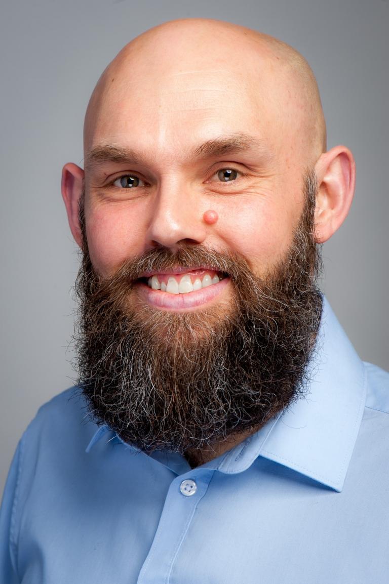 Studio headshot portrait of Joel Ingram